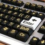 Close up of large font keyboard highlighting the enter key