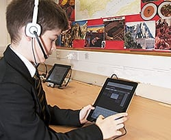 student using iPad headphones