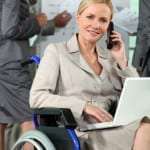 woman in wheelchair at her business